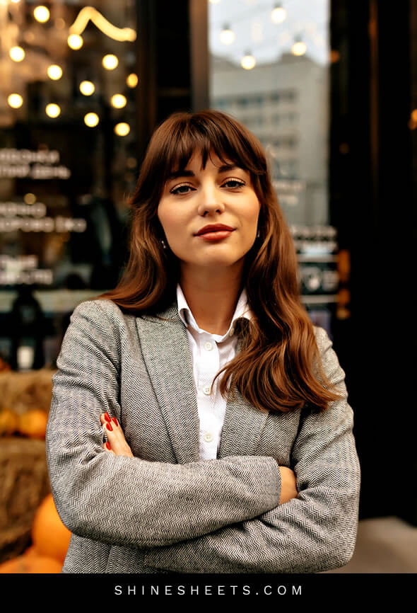 confident beautiful brunette woman looking relieved after work overload decrease