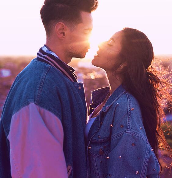 couple in the evening with cute jackets about to kiss