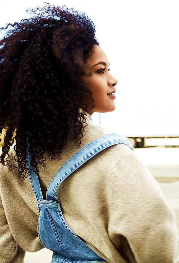 beautiful black woman looking at the horizont with an optimistic look