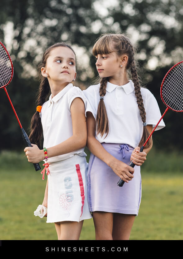 two angry little sister girls playing raquette