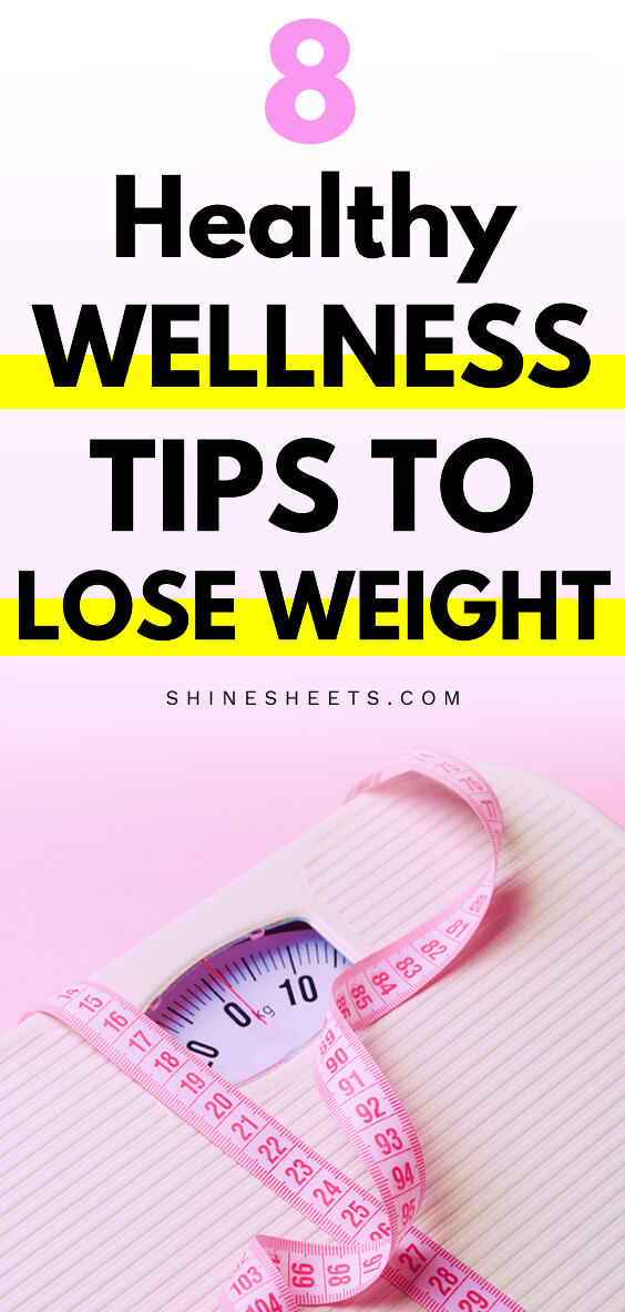 Weight scale on pink background and a pink measuring tape