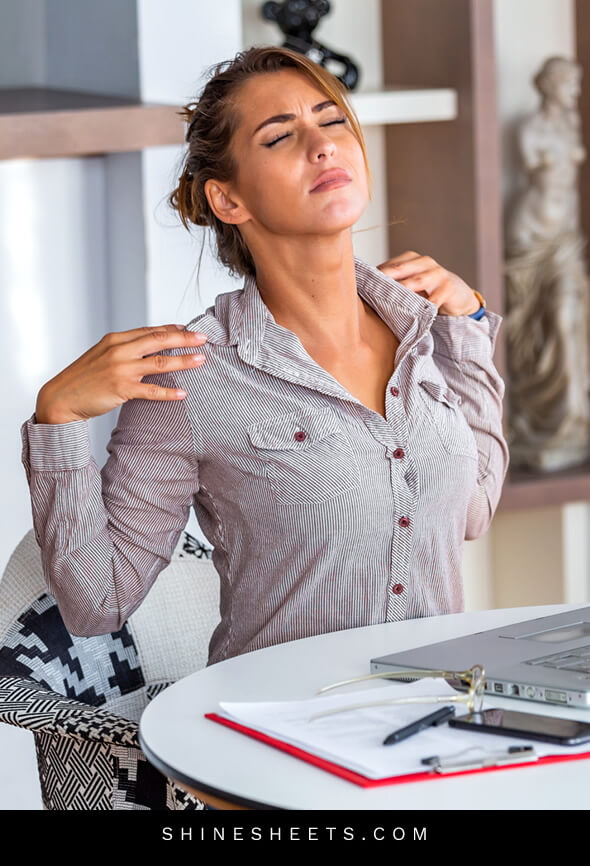 woman dealing with back pain in her face caused by work overload