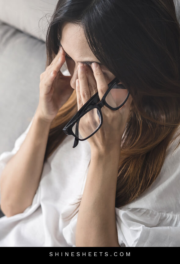 woman looks very tired because she is dealing with work overload