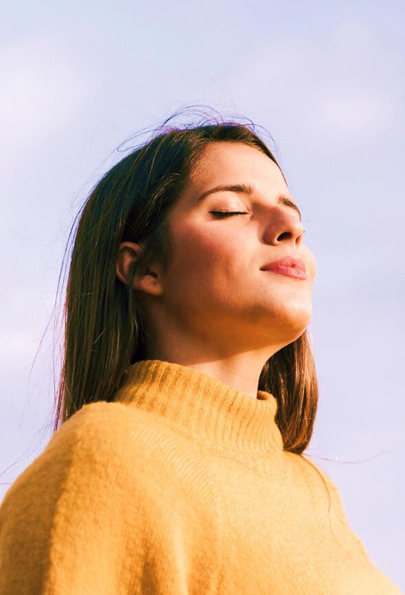 woman taking deep breaths to feel better