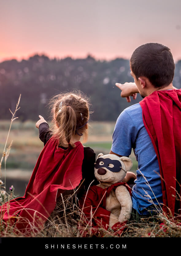 young girl and her father spending time with family by playing super heros