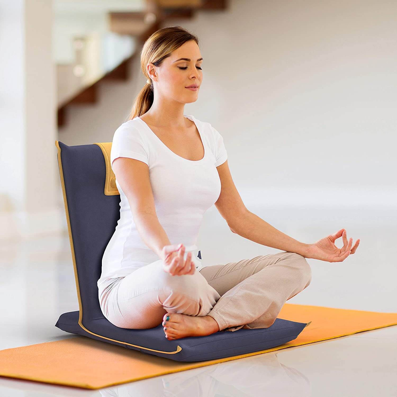 Woman meditation on a foldable meditation chair