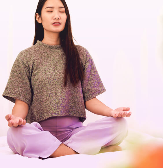 asian woman meditation on a meditation chair cross legged