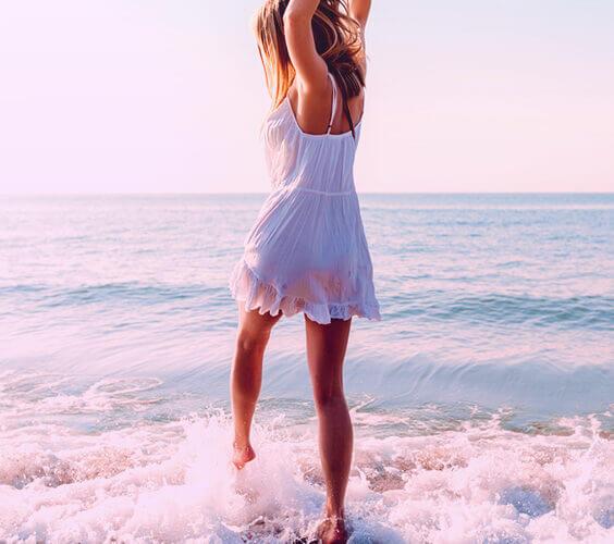 girl enjoying peaceful life at the beach