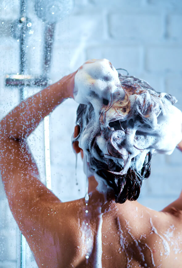 woman shampooing her hair on a hair spa day