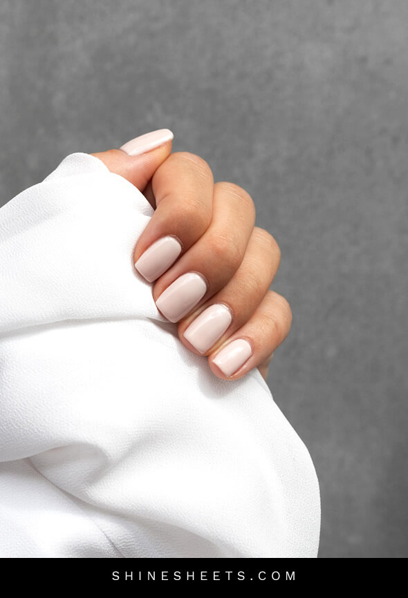 woman showing off her parfectly manicured nails