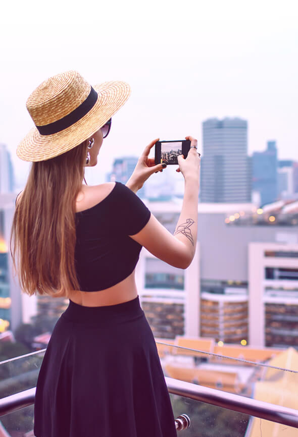 woman taking pictures on the roof top