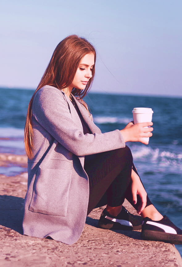 woman with atelophobia sitting by the sea