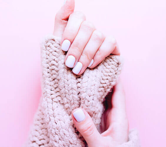 woman with manicure made with gel nail polish