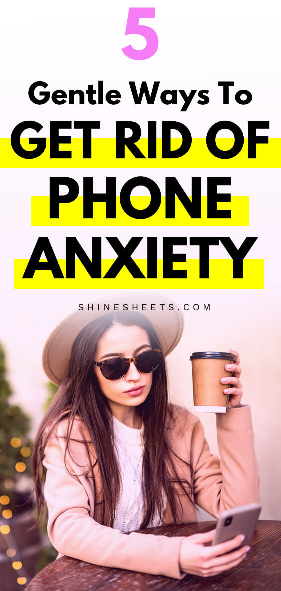 woman with a hat and phone anxiety looking at her phone