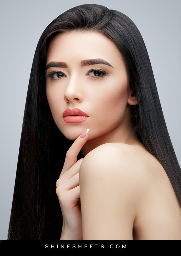 pretty long-haired asian woman with hooded eyes