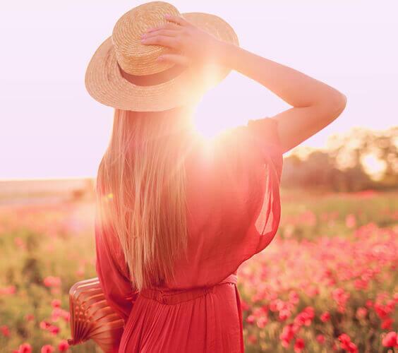 woman walking in the field of sun