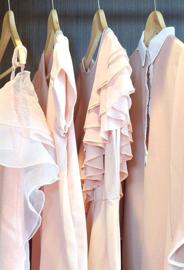 various pink blouses on a hanger