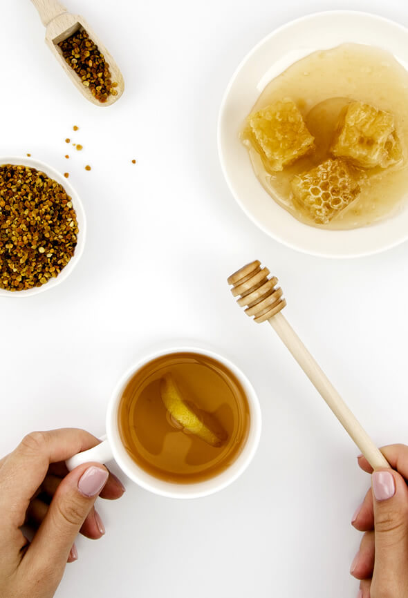 woman making tea with manuka honey and lemon