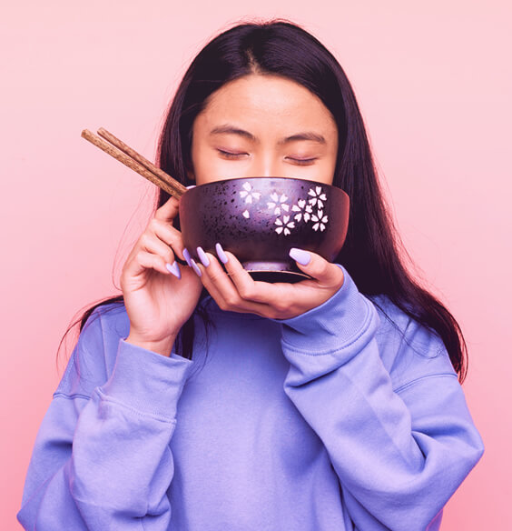 asian woman eating beauty foods from a bowl