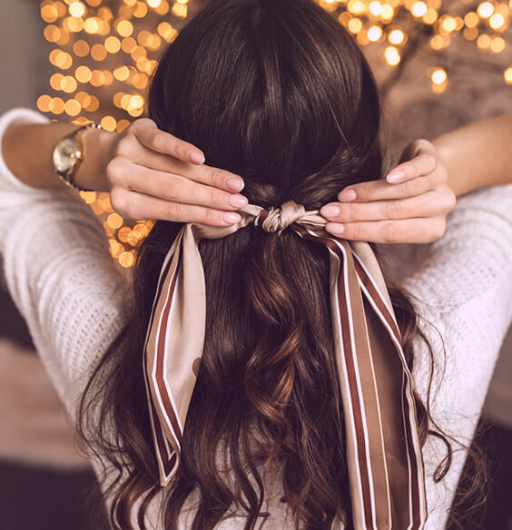 girl with beautiful brown hair and hair bow