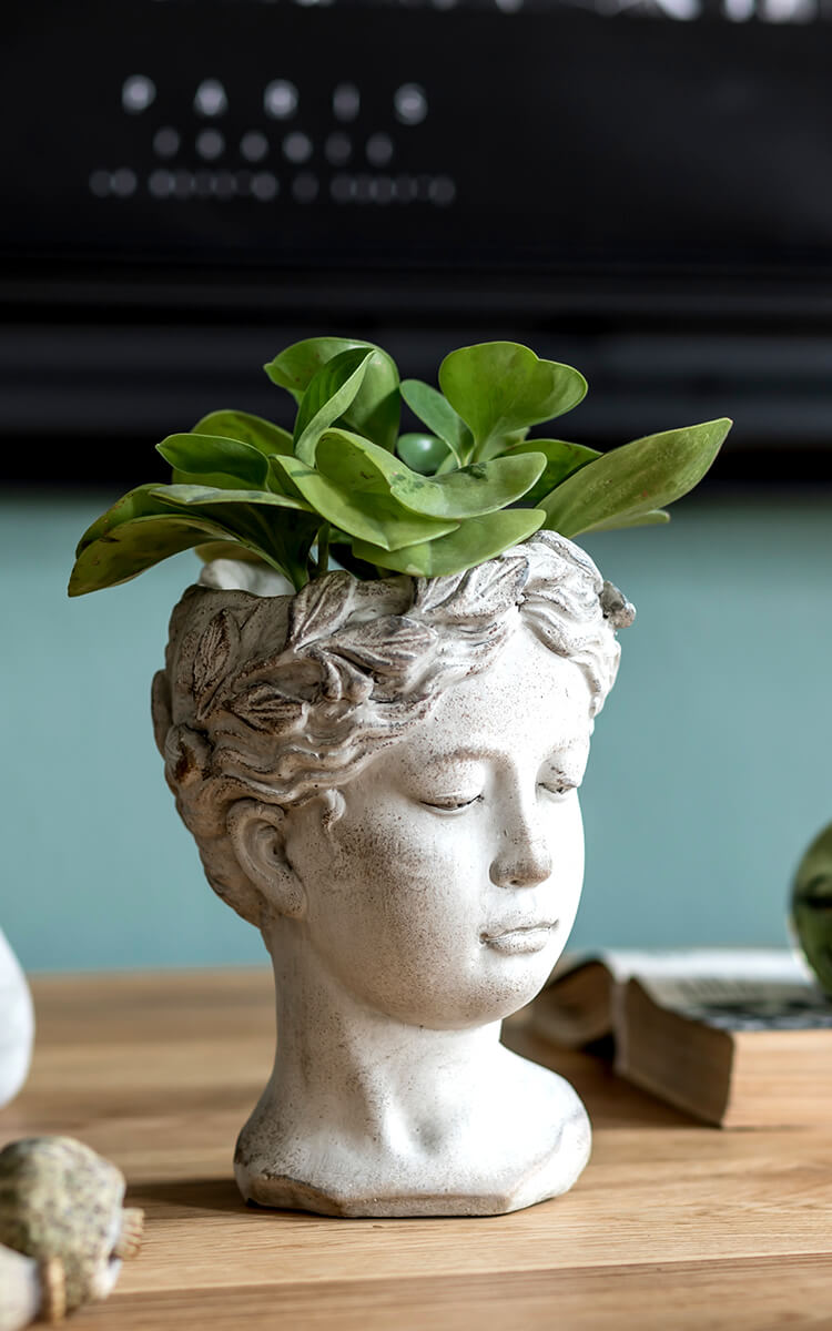 perfectly imperfect head statue