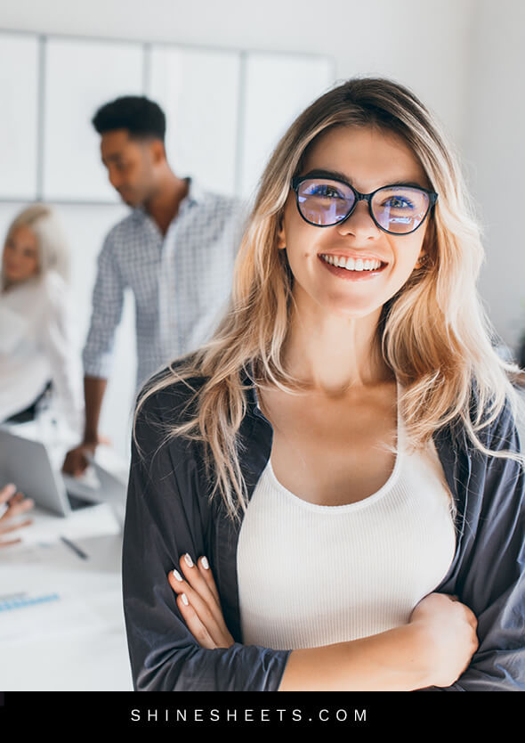 pretty smiling woman with glasses as a symbol of social etiquette at work