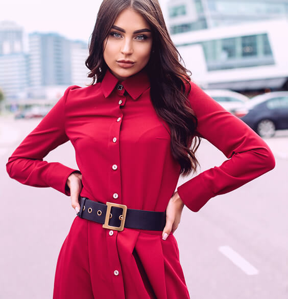 pretty woman in red dress as an illustration of good social etiquette