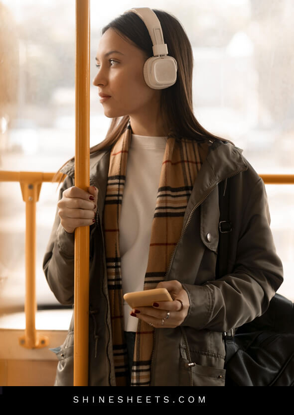 woman listening to music with headphones as an illustration of social etiquette