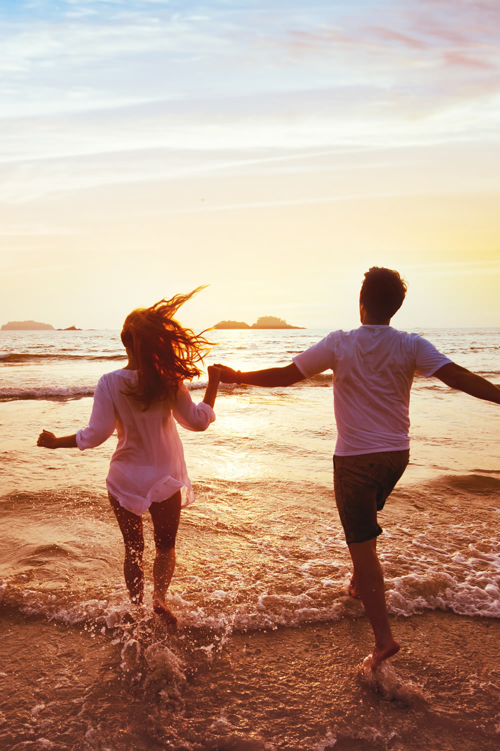 boy and girl having great couple tiem together on the beach