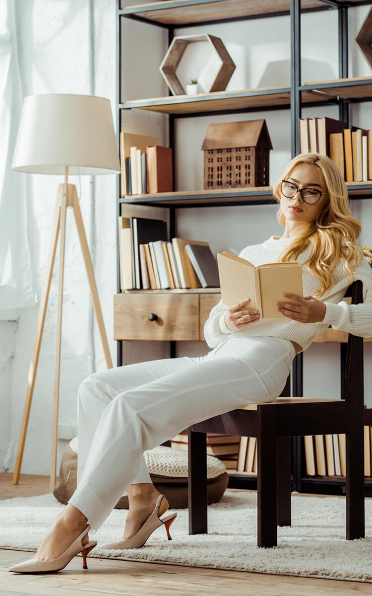 woman reading books to improve intellectual health