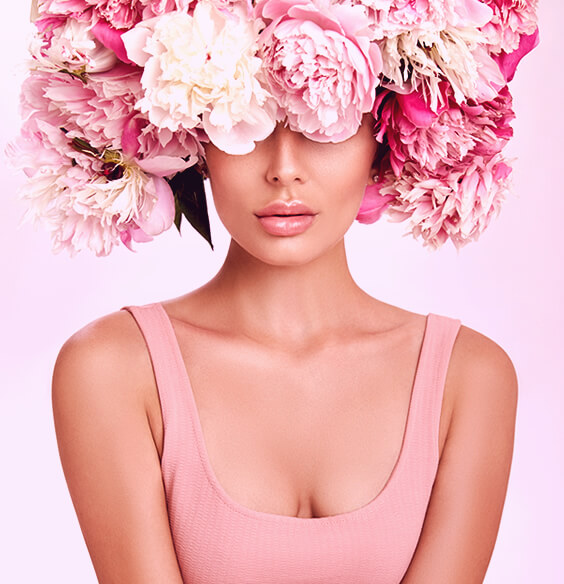 woman with flowers on her head as an art illustration on how to be more feminine