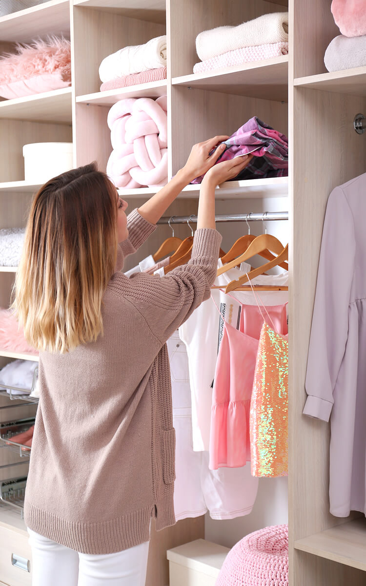 woman organizing kids closet