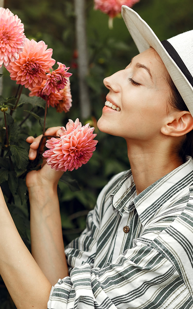 woman enjoying flowers in her garden