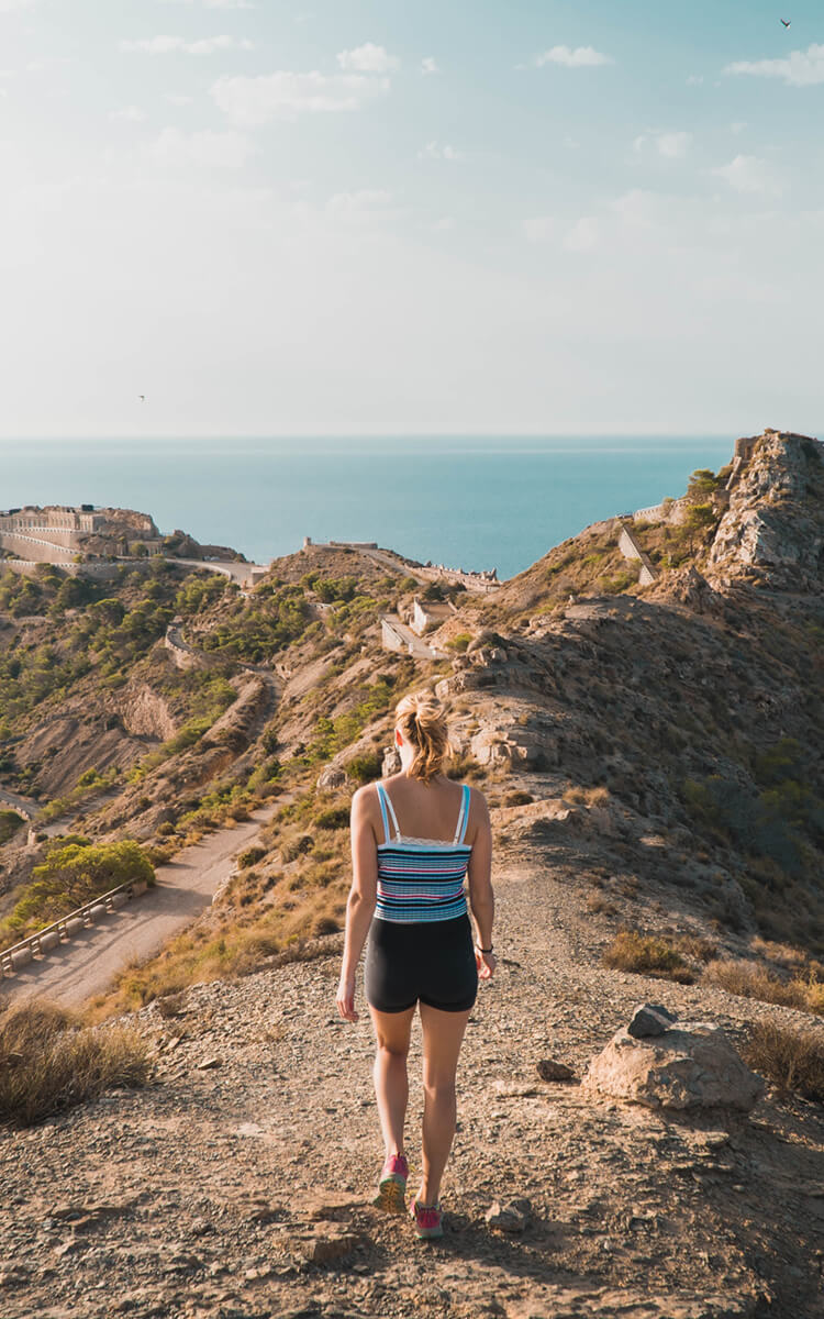 woman exploring different thinking styles by walking in nature