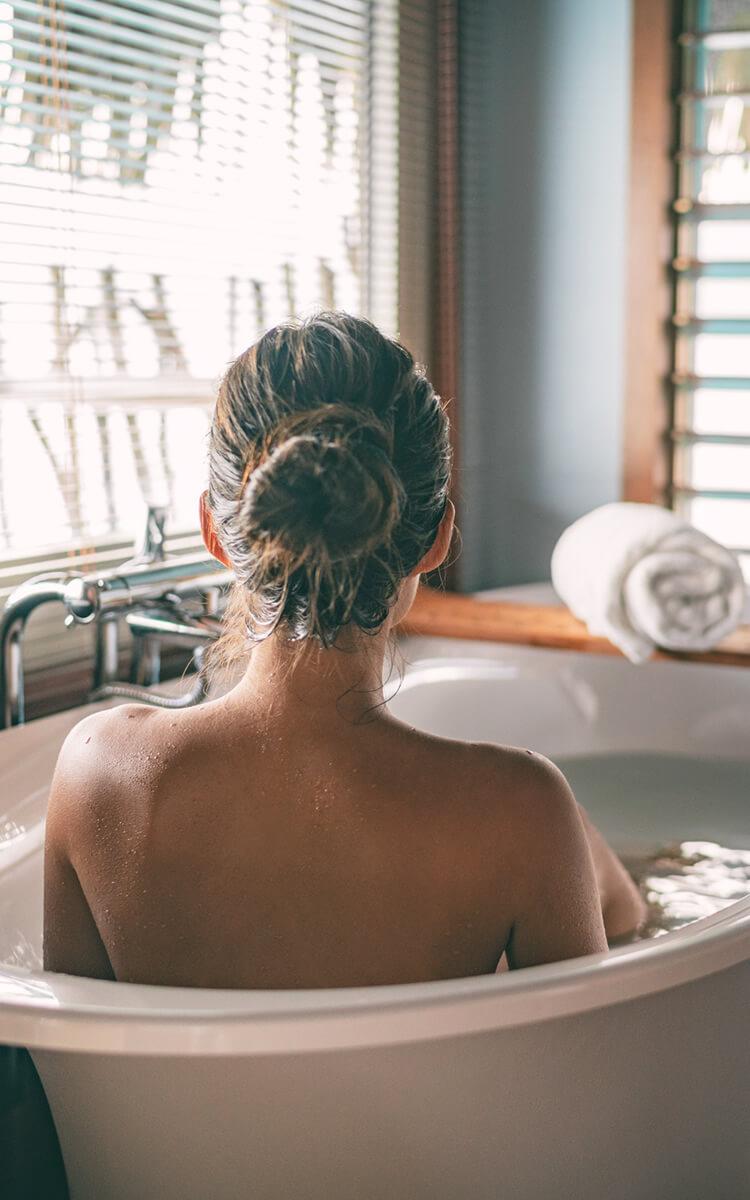 woman having a bath on her self care sunday