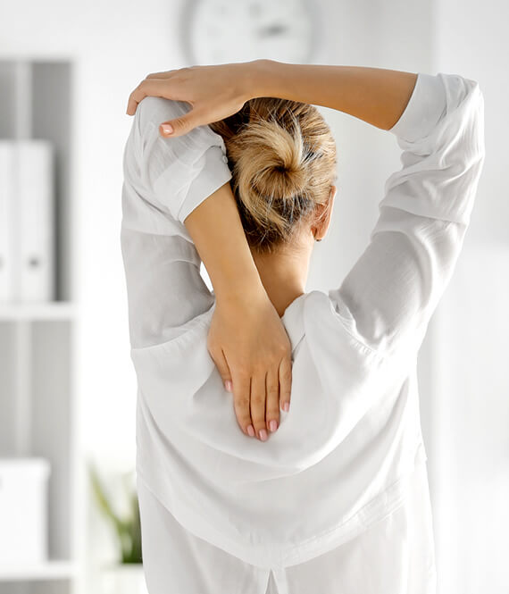 woman having back pain due to bad posture