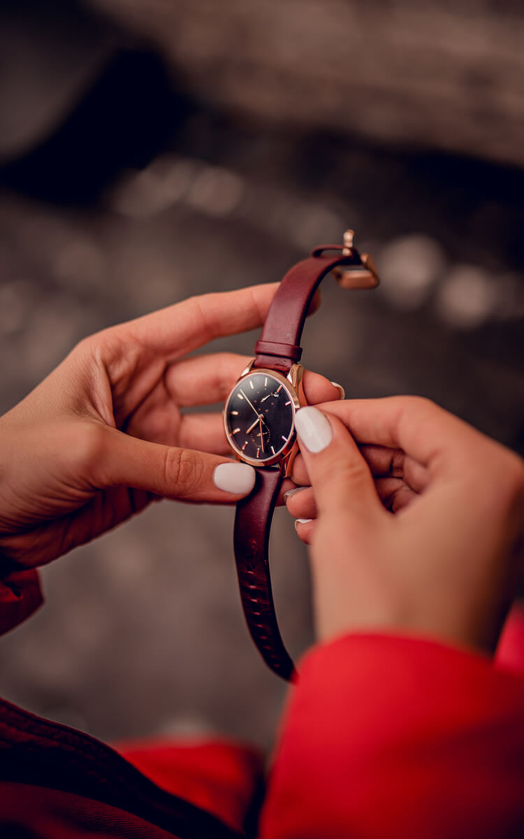a girl looking at her watch