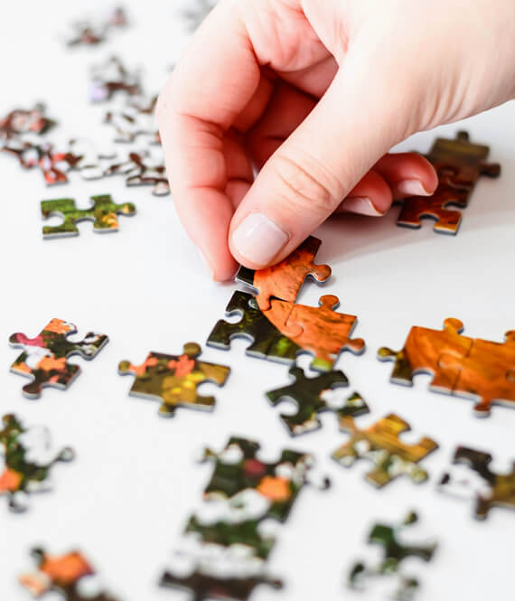 person doing memory care with a puzzle