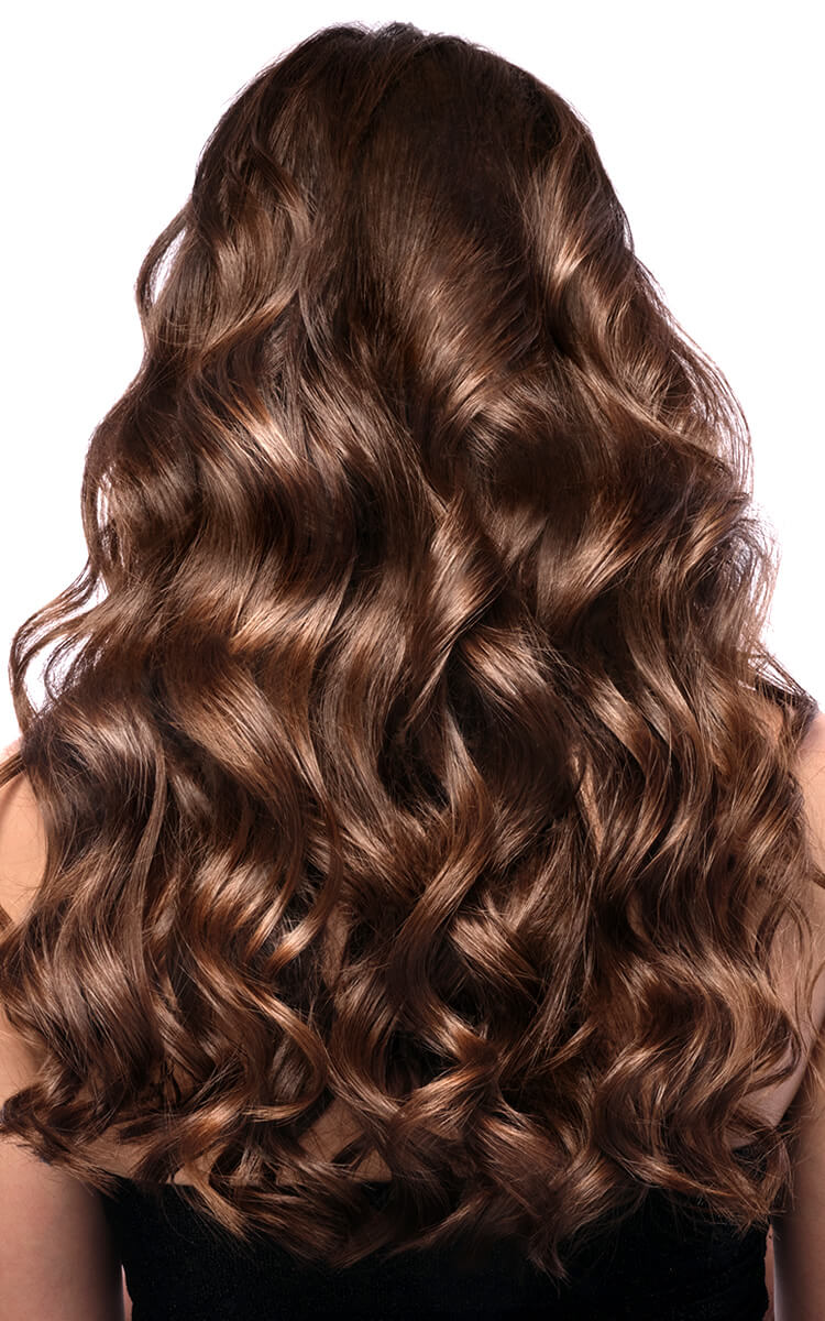 pretty white woman after using olaplex for curly hair