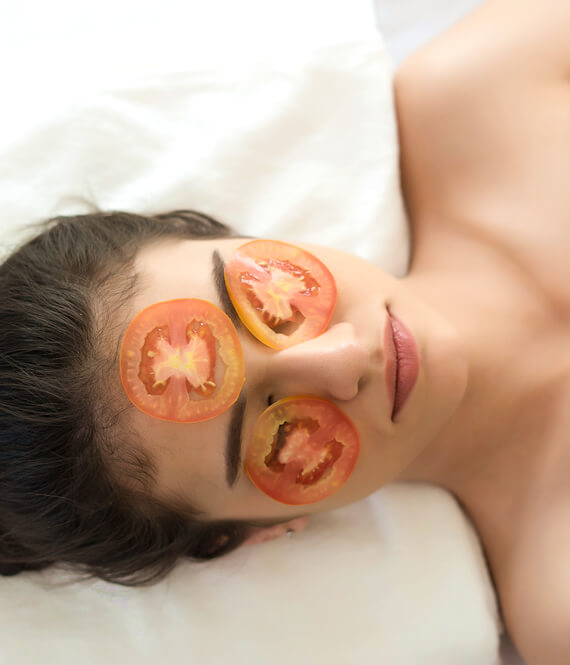 woman relaxing with tomato skincare mask