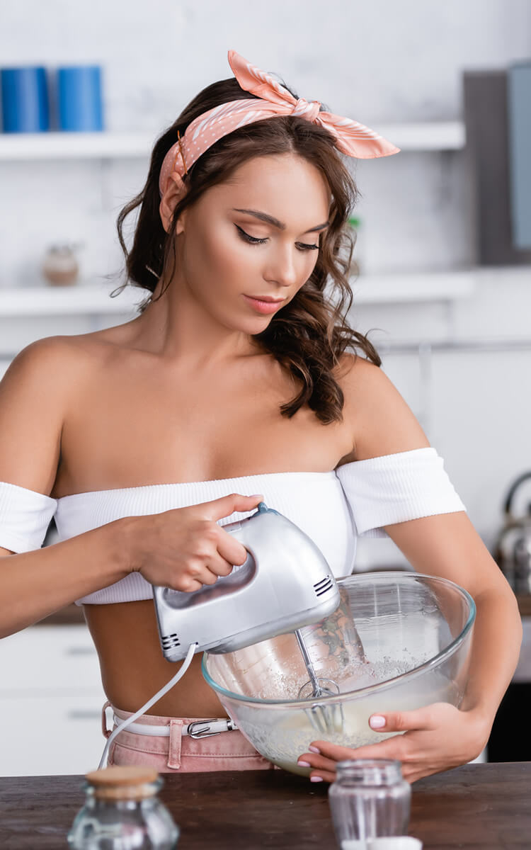 cute student cooking at home to save money