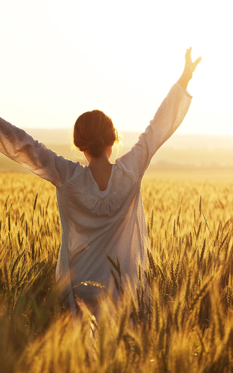 happy woman in the golden fields