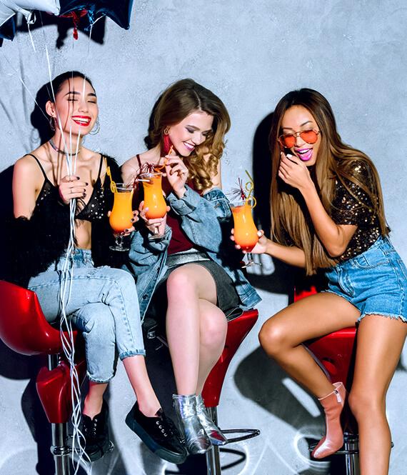 three outgoing multiethnic women having fun