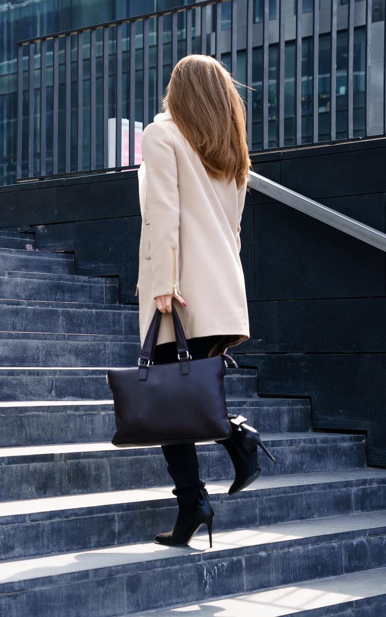 woman climbing steps to success