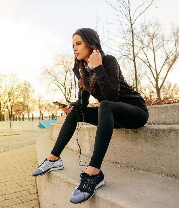 woman listening to self improvement audio book