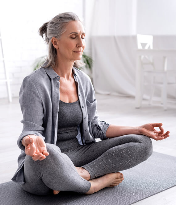 woman meditating on the floor