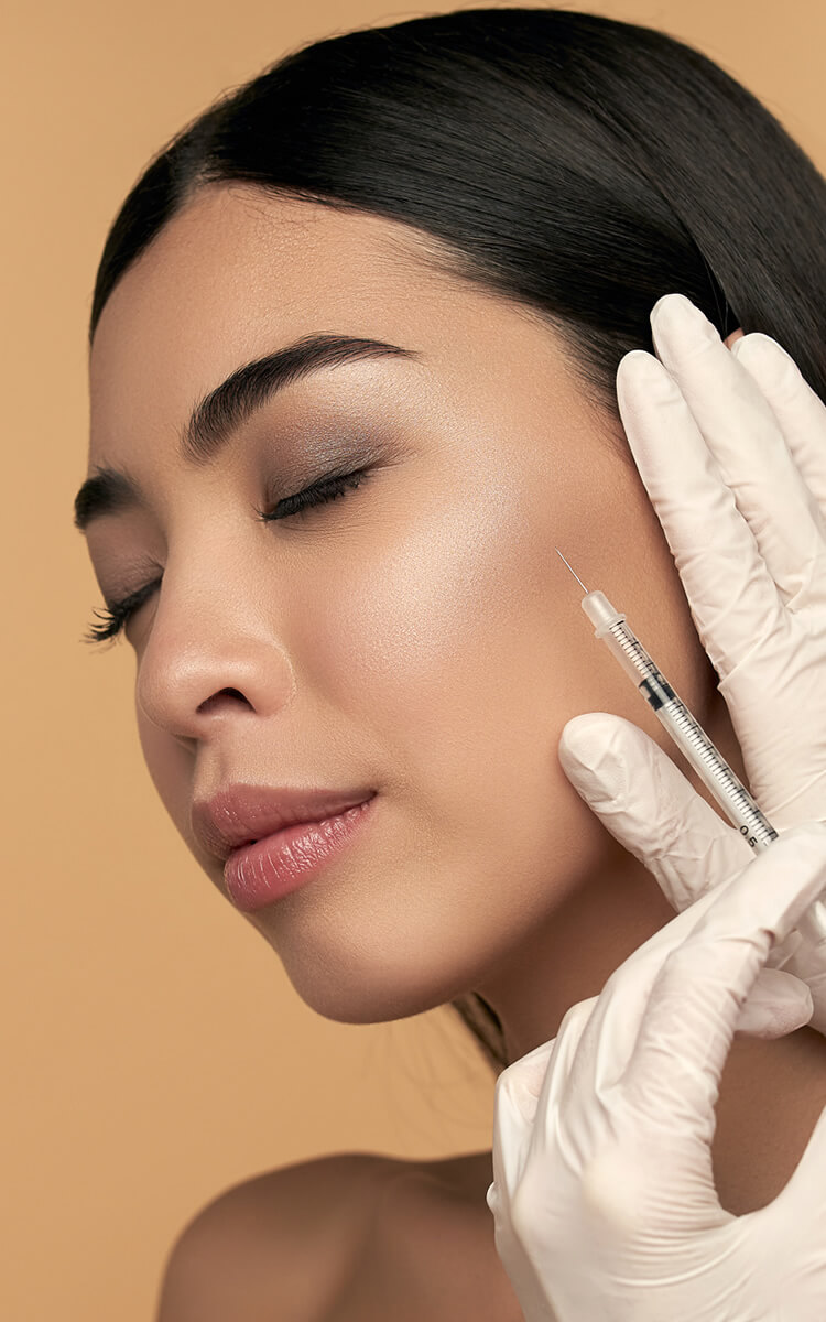 a pretty woman getting botox treatment for wrinkles