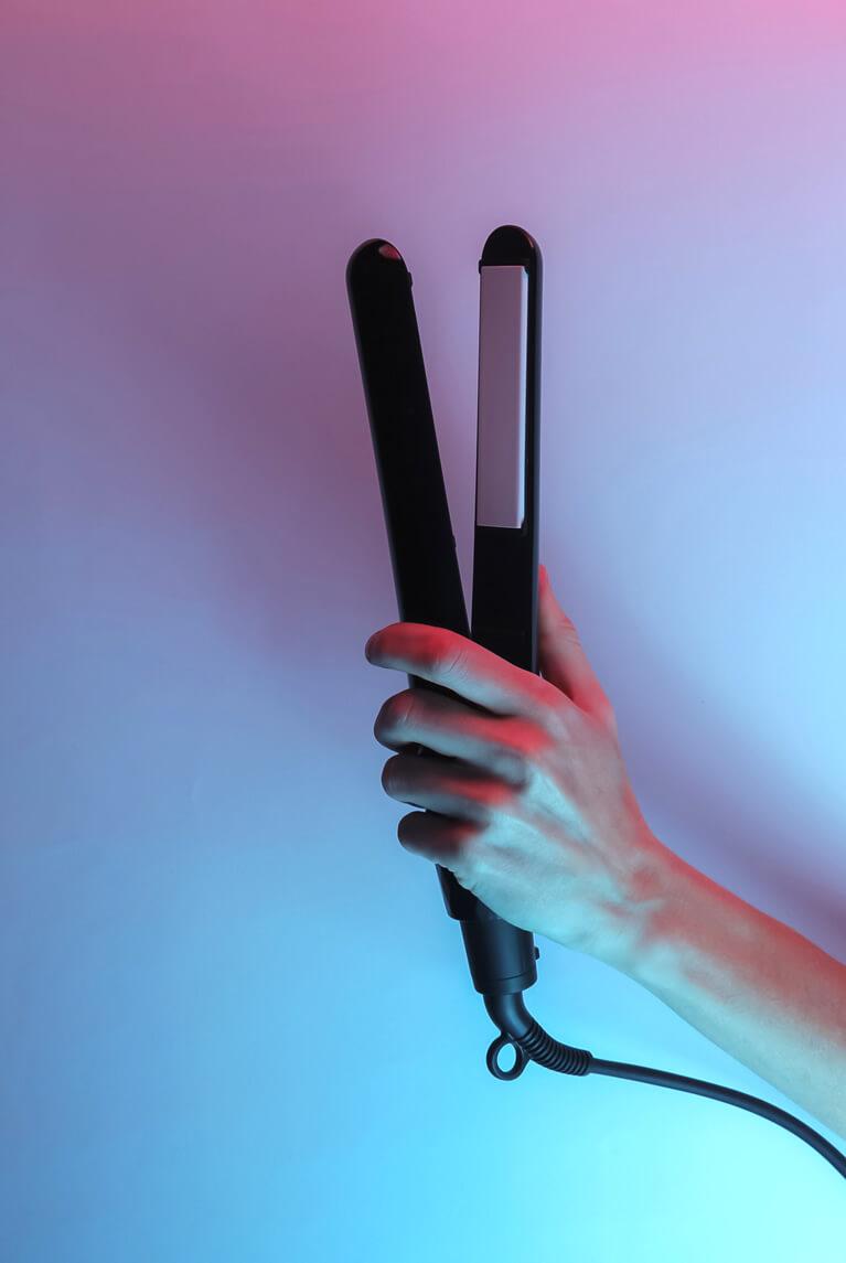 hand holding a hair straightener