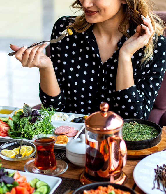 woman eating various collagen rich foods