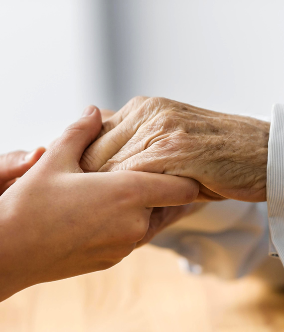 woman holding elderly hands